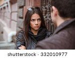 Small photo of Young couple having an argument outdoors