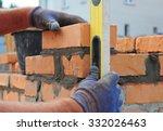 bricklayer using a spirit ... | Shutterstock . vector #332026463