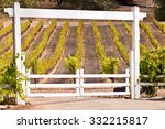 White Entrance Gate And Wine...