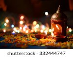 clay diya lamps lit during... | Shutterstock . vector #332444747
