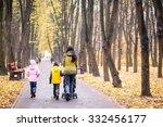 Mum With Three Children Walkin...