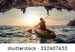 lady paddling the kayak in the... | Shutterstock . vector #332607653