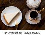 slice of cheesecake and a cup... | Shutterstock . vector #332650337