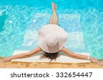 woman in big whire hat relaxing ... | Shutterstock . vector #332654447