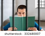 prisoner reading a book in his... | Shutterstock . vector #332680007