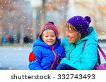 mother and son enjoy first snow ... | Shutterstock . vector #332743493