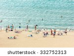 Blurred Beach With Tourist Sit...