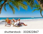 couple on a tropical beach in... | Shutterstock . vector #332822867