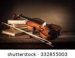violin  bow and old books on a... | Shutterstock . vector #332855003