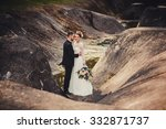bride and groom standing near...   Shutterstock . vector #332871737