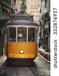 Small photo of LISBON, PORTUGAL - JULY 27: Yellow Tram with people during the day in the historical district. Trams are the symbol of the city, operating since 1873