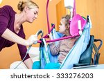 a disabled child being lifted... | Shutterstock . vector #333276203