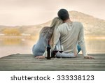 Romantic Couple Sitting On The...