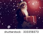 father christmas holding a gift ... | Shutterstock . vector #333358373
