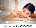 snow against pretty brunette... | Shutterstock . vector #333365063