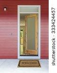open front door with welcome mat | Shutterstock . vector #333424457