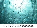 waterdrop in the blue bokeh... | Shutterstock . vector #333456887