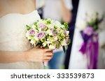 wedding bouquet of purple roses | Shutterstock . vector #333539873
