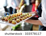 waiter carrying plates with... | Shutterstock . vector #333578117