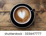 Late Art Coffee On Wood Table...