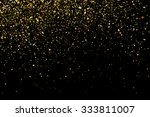 gold glitter texture on a black ...