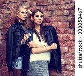 two young fashion women outdoor.... | Shutterstock . vector #333858467