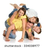cute family  posing on a white... | Shutterstock . vector #334038977