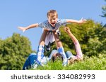family playing with son lying... | Shutterstock . vector #334082993