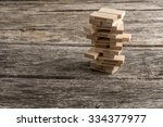 wooden pegs build in a tower...   Shutterstock . vector #334377977