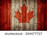 canada flag on old wooden wall | Shutterstock . vector #334477727