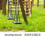 Empty Swings At Playground For...