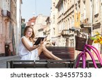 girl with pink bicycle and... | Shutterstock . vector #334557533