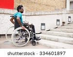 disabled man in a wheelchair... | Shutterstock . vector #334601897