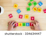 child hand with wooden toy... | Shutterstock . vector #334634447