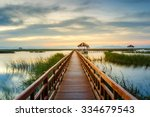 Wooden Bridge In Lotus Lake On...