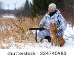 Hunter With Dog On Snowy Field