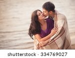 couple in love on the shore... | Shutterstock . vector #334769027