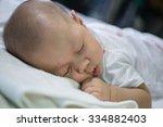asian babies sleep on white... | Shutterstock . vector #334882403