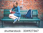 a teenage girl is reading on a... | Shutterstock . vector #334927367