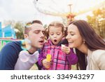 beautiful young family enjoying ... | Shutterstock . vector #334943297