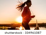 female runner jogging on... | Shutterstock . vector #334961087