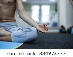 young man in meditation on the... | Shutterstock . vector #334973777