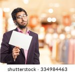 happy businessman with placard | Shutterstock . vector #334984463