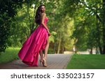 young beautiful woman in long... | Shutterstock . vector #335023157
