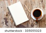 brown note book with coffee cup ... | Shutterstock . vector #335055323
