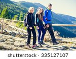 parents with daughter hikers... | Shutterstock . vector #335127107