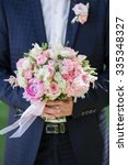 Groom Hold Wedding Bouquet In...