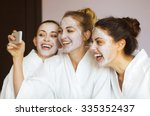 three young happy women with... | Shutterstock . vector #335352437