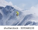 flying skier on mountains ... | Shutterstock . vector #335368133