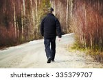 An Older Man Is Walking On The...